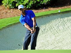 Tiger Woods hits out of a greenside bunker on No. 13 during Monday's practice round of the 2012 Masters Tournament at Augusta National Golf Club on April 2, 2012, in Augusta, Ga. http://www.Augusta.com