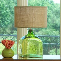 fyi to all the lovely ladies that love colored glass home decor..i saw in the belford, va marshalls that they had a teal lamp similar to this one, but more oval & larger glass for 20some or 30some dollars. which means that other Marshall's could have similar items too! exciting!