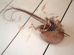 Rhea - Curled pheasant feather fascinator. $100.00, via Etsy.