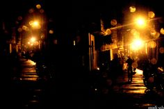 Tempatations to walk the golden lit pathway in a monsoon night.