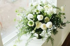 Wild-looking green-and-white centerpiece with wispy ferns and Queen Anne's lace   Photo by Brooke Stapleton   Floral design by Julia Smith