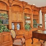 Oversized crown moldings, detailed wainscoting and appliques, rich hardwood floors and plenty of built-in storage make this Franklin Lakes, N.J., estate's home office the perfect place to conduct  business .   | HGTV FrontDoor