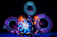 Blacklight Show Cosmic creatures with luminous tools show the dance of future in almost absolute darkness, which lets their UV-reflective costumes and masks come up. Circus Art, Cosmic, Darkness, Masks, Creatures, Dance, Pure Products, Costumes, Tools