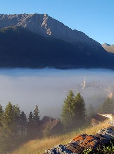 Morning mist over the Engadin Valley, Graubünden, Switzerland (by upsa-daisy).