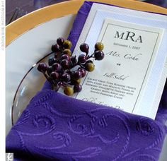 Guests sat in one of four dining rooms, each with its own color and theme. Every place setting featured a deep purple napkin with a menu tucked inside. For an added natural element, blackberry sprigs, star anise, fiddlehead ferns, or hazelnuts accompanied...