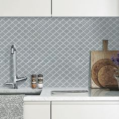 Renovate any wall, flat or curved, with these glasslike tile sheets at a fraction of the price of regular tiles.