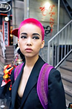 Gotta admire anyone that can pull off this look. What a badass. don't know what she used on her hair, but MANIC PANIC® New Rose™ is a close match.