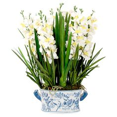 Add a natural touch to your entryway console table or living room mantel with this eye-catching faux floral arrangement, showcasing Vanda orchids in an eye-c...