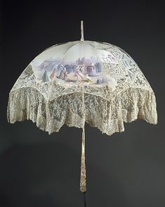 Accessory set, ca.1896 consisting of a parasol and two fans in a leather case..Made of silk, linen, bone, wood, leather..Parasol.