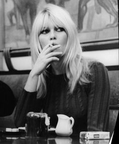 Brigitte Bardot portrays the role of ''Herself in bistro'' in the film '' Masculin Feminin'' ''Αρσενικό - Θηλυκό'', a 1966 French-Swedish New Wave one directed by Jean-Luc Godard. Bridgitte Bardot, Bardot Bangs, My Hairstyle, Hairstyles, Jane Birkin, French Actress, Girl Smoking, Smoking Ladies, Women Life