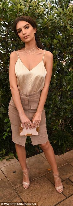 Not too risque: Emily Ratajkowski attended the Net-A-Porter Women Behind the Lens event in LA on Friday where she flashed a fair amount of skin in a tan silky top which she tucked into a complementary skirt