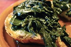 fettunta topped with kale- the grilled tuscan bread, can be served as is-- or with tuscan beans or kale