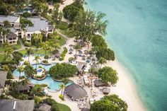 Hilton Mauritius Resort & Spa Flic-en-Flac This luxurious 5-star Hilton resort has a beachfront location 4 km from Flic en Flac.  It offers on-site diving tuition, a choice of 4 restaurants and a lagoon-style swimming pool.