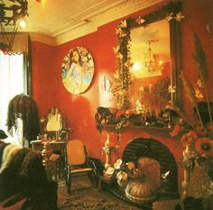 Red Bohemian room. Yes love the red color and the gold withv the mirror.
