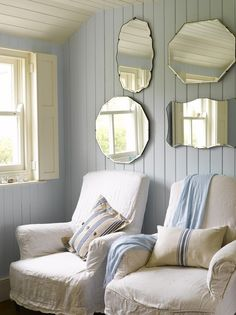 Mirrors, slipcovered chairs, pillows, wall color