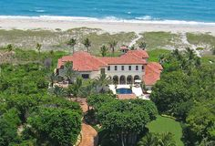 969 South Ocean Boulevard, Delray Beach, Florida: Set on two acres of prime oceanfront property with 150 feet of frontage, this remodeled European-inspired estate evokes a timeless elegance in every room, with six bedrooms, seven full baths, three half baths and an unsurpassed attention to detail. Upon entry, a winding gated drive gives way to panoramic ocean views and an intricately tiled vaulted loggia.