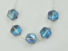 I can think of so many things I would wear this with... @Etsy iridescent blue geometric shape glass necklace