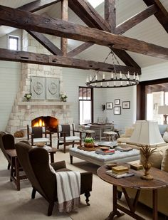 Living room ideas farmhouse design exposed beams large square ottoman vintage tables