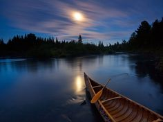 Moonlit Canoe, Allagash River Photograph by Michael Melford, National Geographic Moonlight bathes a birchbark canoe on Maine's Allagash River, a tranquil spot for paddlers. S4 Wallpaper, Nature Wallpaper, 1920x1200 Wallpaper, Apple Wallpaper, Computer Wallpaper, Screen Wallpaper, Mobile Wallpaper, National Geographic, Parks In New York