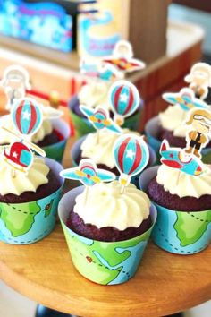 Check out the fun cupcakes with airplane and hot air balloon toppers at this vintage airplane 1st birthday party! See more party ideas and share yours at CatchMyParty.com #catchmyparty #partyideas #4favoritepartiesoftheweek #airplane #airplanecupcakes #airplaneparty