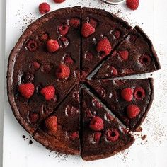 Chocolate & raspberry are excellent bedfellows - fruity and rich, this tart is an easy dinner party favourite - recipes on HOUSE - design, food and travel by House & Garden.