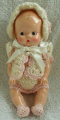 Vintage hard plastic baby doll in pink and ivory outfit...so cute!