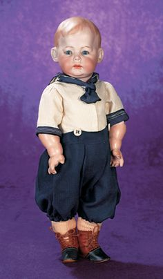 """18"""" (46 very full cheeks,composition and wooden ball-jointed toddler body with side-hip jointing. ~Generally excellent. Fany 230 A 7 M.~Marseille,circa 1912. Superb example of the rare pouty character,having exemplary bisque and modeling,wonderful chubby toddler body,antique sailor costume. Solid domed bisque socket head,painted brown boyish hair with forelock curls,stuck-out ears,small blue glass sleep eyes,curly lashes,short feathered brows,accented nostrils and eye corners. $8250.00 SOLD"""