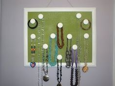 Keep your jewelry organized and looking stylish with this great DIY Jewelry Organizer made with fabric, knobs, and Gorilla Glue!