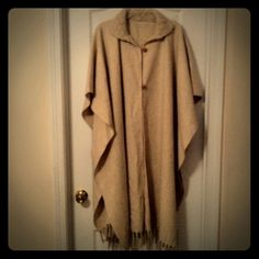 Cream wool long poncho Cream colored wool poncho with knit collar faux wooden buttons and fringe at bottom.. Will keep you nice and warm this winter... Re-poshing... Love it but not quite my style.. Looking for a forever home!! Bundles & Paypal available Jackets & Coats