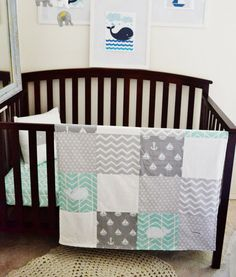 Nautical whale nursery bedding crib set. Mint, grey gray, and white patchwork blanket quilt featuring whales, anchors, and sailboats with a minky back. Perfect for a crib or toddler's bed.