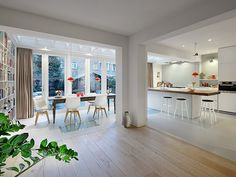 via Bloem en Lemstra Architecten. Dining/kitchen space with a LOT of natural light through big wall doors. Wide open space plan. Another angle.