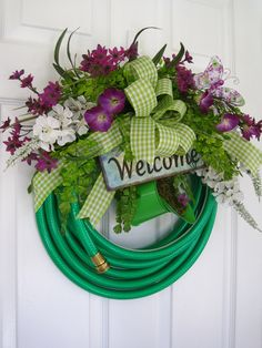 GARDEN HOSE WREATH- Purple Flowers- Welcome- Sign- Watering Can- Free Shipping. $100.00, via Etsy.