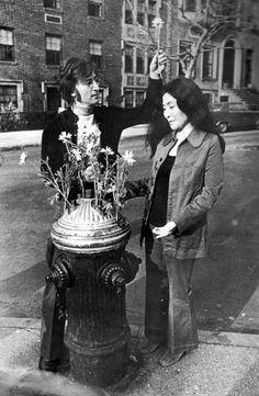 "John Lennon & Yoko Ono, the ""flower hydrant"" outside their Greenwich Village apartment, 1971."
