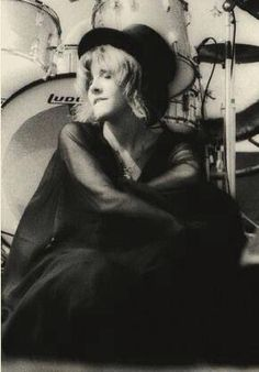 Stevie seated in front of Mick Fleetwood's drums; she's wrapped herself in her sheer black chiffon shawl, and is biting her lower lip  ☆♥❤♥☆