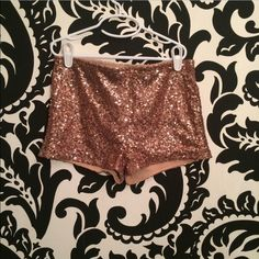 sparkly copper shorts fitted size small. in grey condition only worn once for New Year's Eve! really cute and flattering Shorts