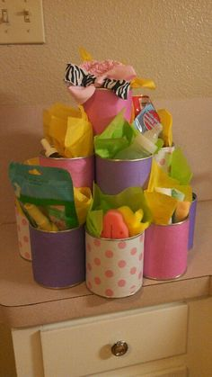 Old formula cans, tissue paper, hot glue and misc items make a great baby shower gift basket!!