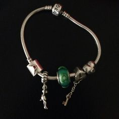 gorgeous love pandora bracelet with 5 charms Monkey means I was clingy . The love letter the teal crystal, key to my heart and pink heart. Must sell! ( ex boyfriend stuff). All very beautiful charms. Excellent conditions! Pandora Jewelry Bracelets