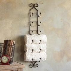 Love this!!! Re-purpose a wine rack - gotta be better than those over the toilet shelf things.
