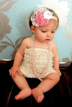 I don't know what it is about little girls wearing pearls and big flower head bands but I love it! =)