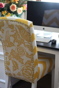 Love the pop of color on this no-sew reupholstered chair.  Fabric is Zippy by Premier Prints and Aviary in Maize by Thomas Paul (Calico Corners). Nailhead trim is Dritz Home Decorative Nails in nickel (JoAnne Fabrics)