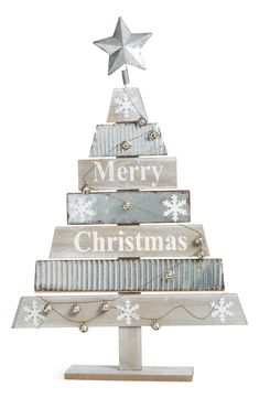 Rustic tabletop tree painted with snowflakes and festive 'Merry Christmas' lettering Wooden Christmas Decorations, Christmas Wood Crafts, Farmhouse Christmas Decor, Diy Christmas Tree, Christmas Signs, Rustic Christmas, Xmas Tree, Christmas Projects, Merry Christmas