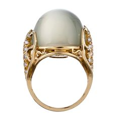 HENRY DUNAY Cabochon Moonstone and Diamond Ring   From a unique collection of vintage cocktail rings at http://www.1stdibs.com/jewelry/rings/cocktail-rings/
