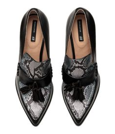 High-heeled pumps in black snakeskin-patterned leather with decorative tassels at front and rubber soles. Heel height 4 in.    H&M Shoes