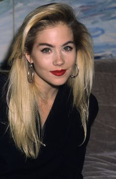 """""""A young and fresh Christina Applegate with that delicious late-80s bimbo look: bleach-blonde hair with dark roots showing, frosty white skin, dark bushy eyebrows, luscious blood-red matte lipstick. It helps she is physically beautiful. But horrifying on anyone else."""""""