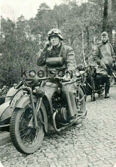 A SS soldier with his BMW with the Steib side car German Soldiers Ww2, German Army, Bmw Motorcycles, Vintage Motorcycles, Cycle Pictures, Germany Ww2, Vintage Cycles, War Dogs, Military Pictures