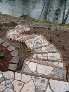 Stone surrounded by border - step down patio from deck