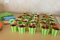 """dino party: pterodactyl nests (pretzel sticks and grapes) also like the """"deviled dino egg"""" name"""