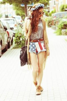 Fringe cardigan, American flag shorts, brown leather belt, gray graphic T-shirt, flower headband
