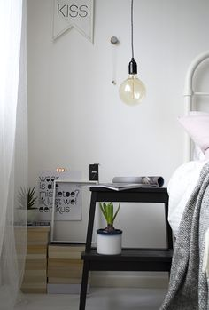 A BEKVAM stool makes a great bedside table in blogger @TiffGrantRiley cosy winter bedroom makeover.
