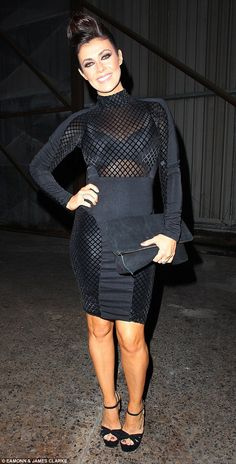 Wow factor: Kym, 39, showed off her toned curves in her sexy little black dress, which featured a sheer top half